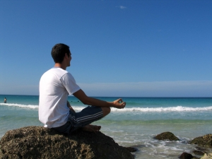 Man-Meditating-on-beach